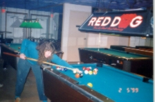 Angela shooting pool